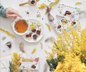 chocolate, cup of tea, and flowers image