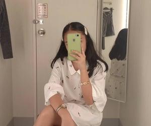 filipina and mirror shot image