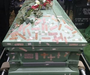 coffin and flowers image