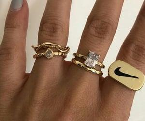bracelet, earrings, and gold image