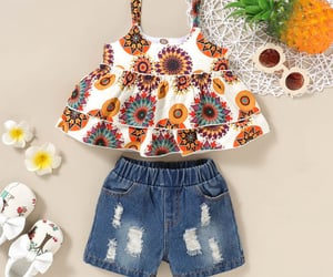 ripped jeans shorts, pretty flower print, and strapless top image
