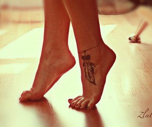 feather, leg tattoo, and photography image