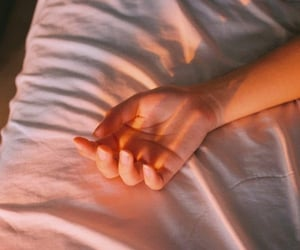 hand and bed image
