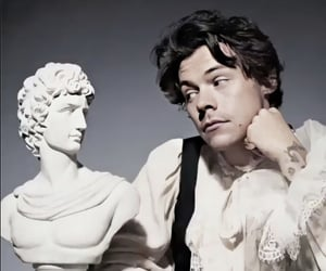 Harry Styles and statue image