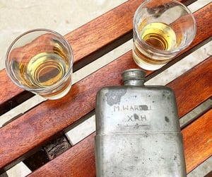 alcohol, bench, and brown image