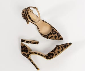 ankle strap, pointed toe, and leopard print image