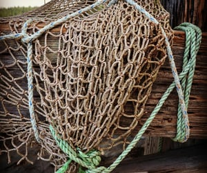 dock, nets, and fishermen image