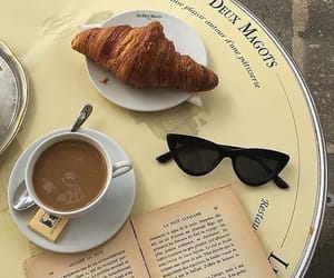 coffee, croissant, and book image