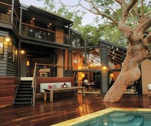 house, pool, and tree image