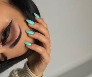 blue nails, eye, and feed image