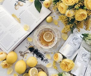 book, flowers, and lemon image