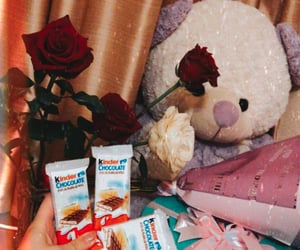 bear, kinder chocolate, and flowers image