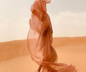 artist, shawl, and sun image