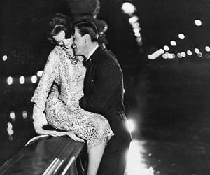 Carmen (in Yves Saint Laurent for Dior) and Robin Tattersall on the Pont Alexandre III, photo by Avedon, Paris, August 1957