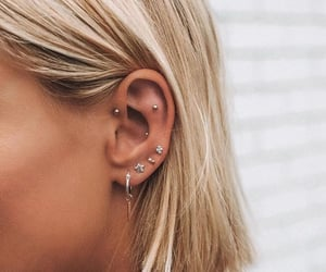 blonde, earrings, and silver jewelry image