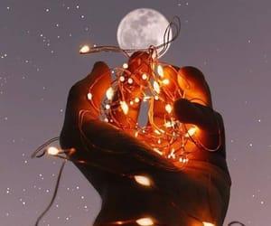 hand, lights, and moon image