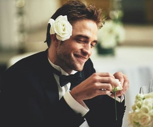 robert pattinson, flowers, and actor image