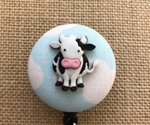 cow, id holder, and id badge reel image
