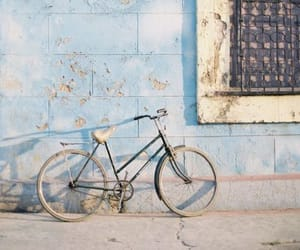 bicycle, blue, and wall image