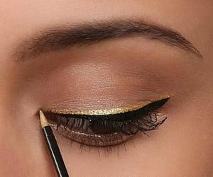 makeup, gold, and eyeliner image
