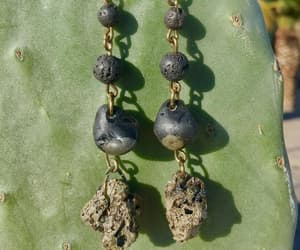 earrings, black earrings, and lava stone image