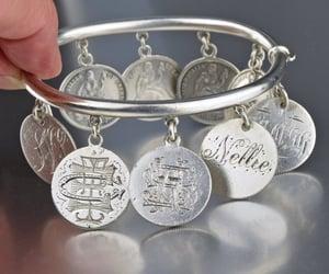 bracelet, token, and charm image