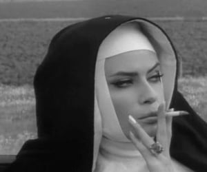 nun, black and white, and smoke image