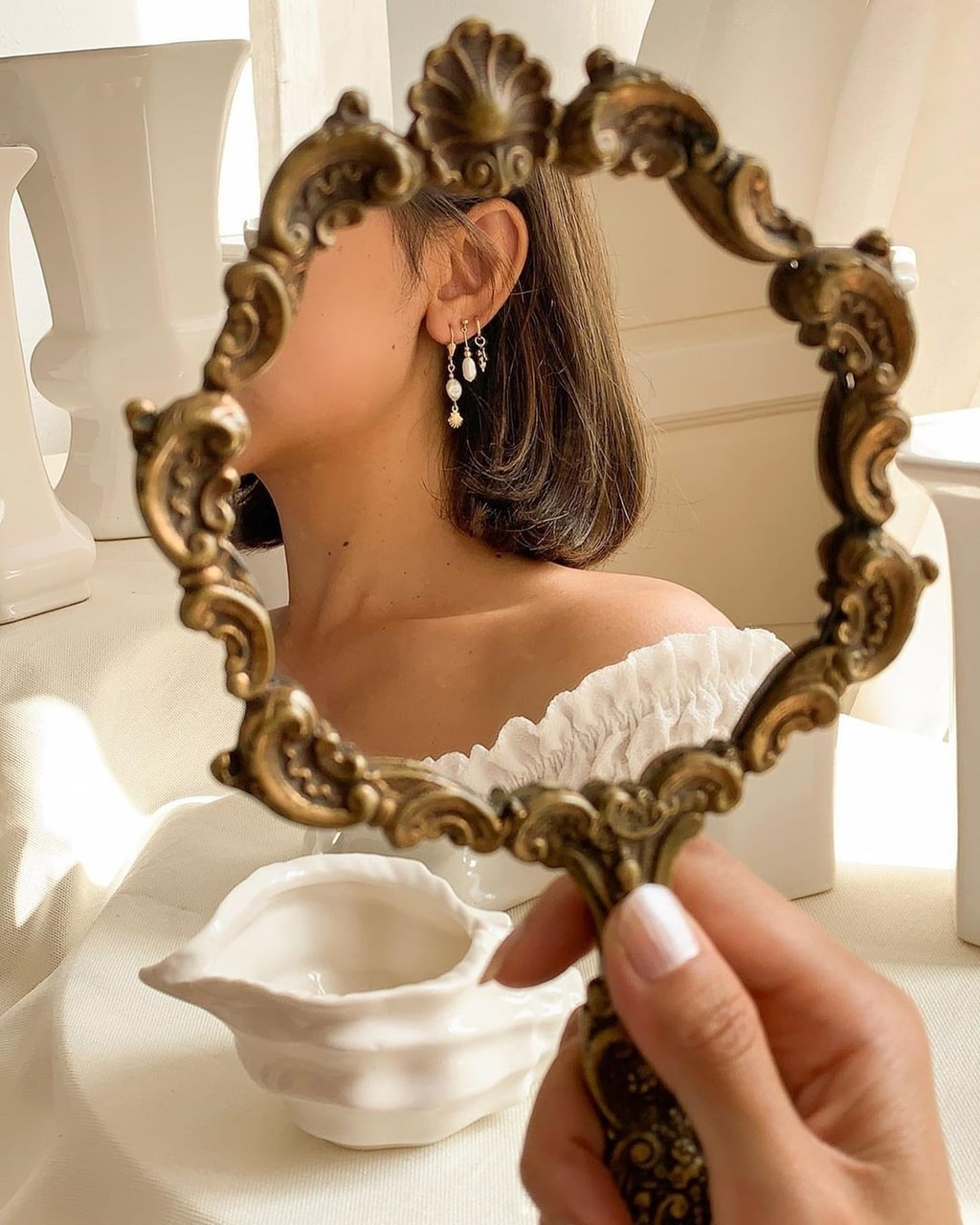 article, barrette, and earrings image