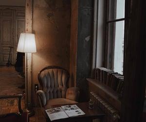books, lamp, and window image