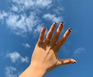 black, blue sky, and clouds image
