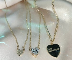 diamonds, gold chains, and jewelry image
