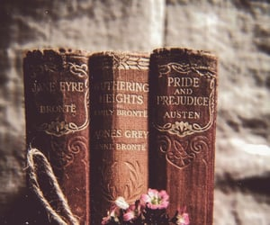 book, flowers, and golden image
