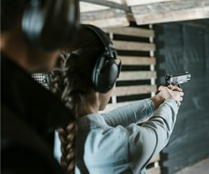 girl, gun, and long hair image