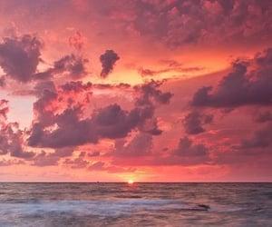 sunset, sky, and sea image