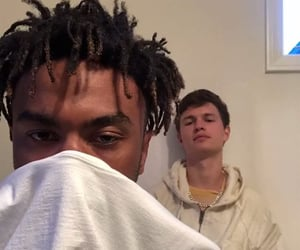 ansel elgort, ian simpson, and kevin abstract image