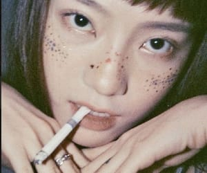 cigarrettes, freckles, and smoke image
