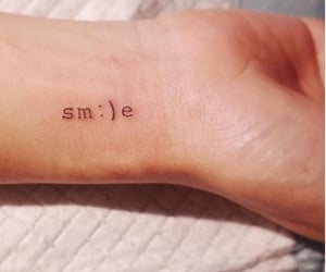 smile and tattoo image