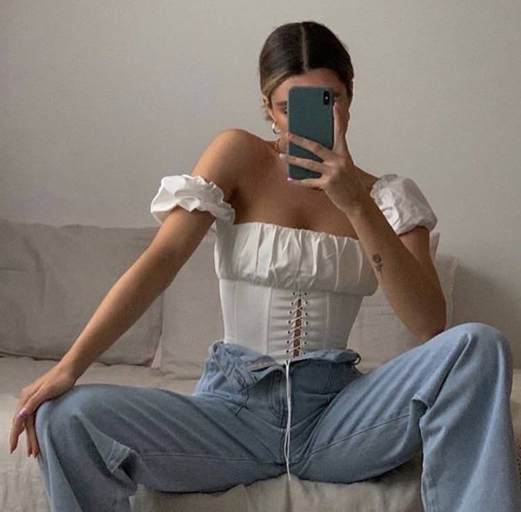 high waisted jeans, flared jeans, and white corset top image