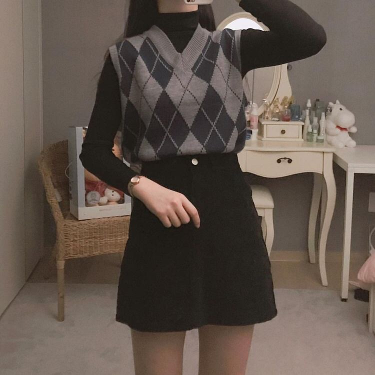 sleeveless sweater, black skirt, and black turtleneck image