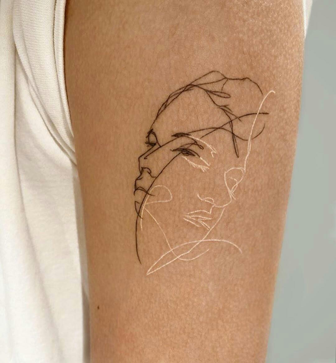 2 faces tattoo