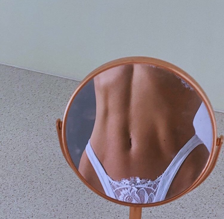 body, abs, and fit image