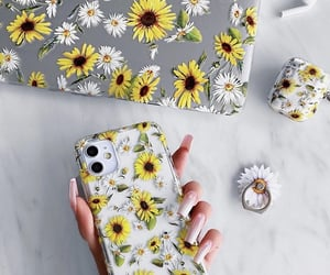 flowers, iphone, and laptop image