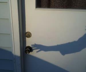 door, shadow, and hand image