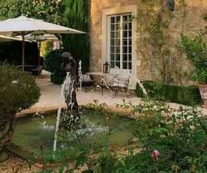 backyard, fountain, and garden image