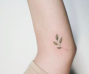 green and tattoo image