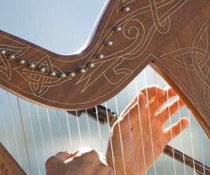 hands, harp, and music image