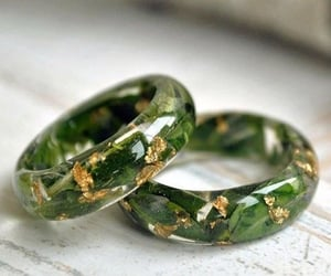 crystal, golden, and green image
