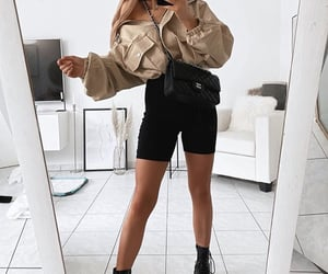beige, black, and clothes image