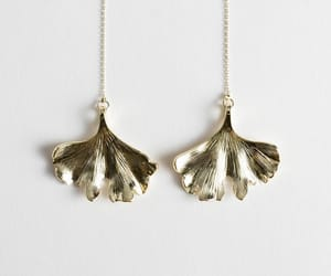 gold earrings, ginkgo leaf, and and other stories image