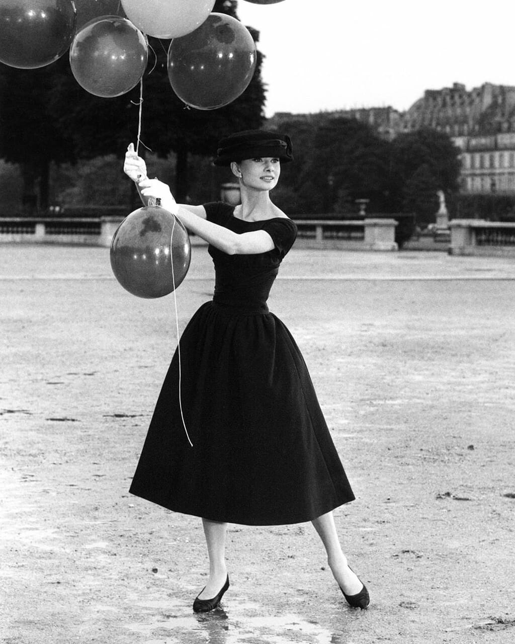 audrey hepburn, balloons, and black and white image